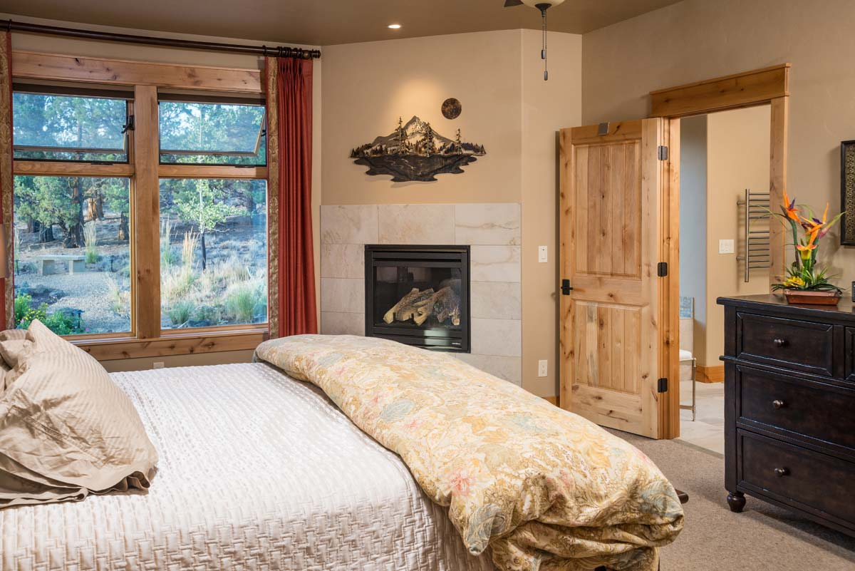 Brasada ranch custom home designer the original approved for Master bedroom corner fireplace